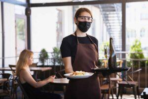 waitress-works-restaurant-medical-mask-gloves-during-coronavirus-pandemic